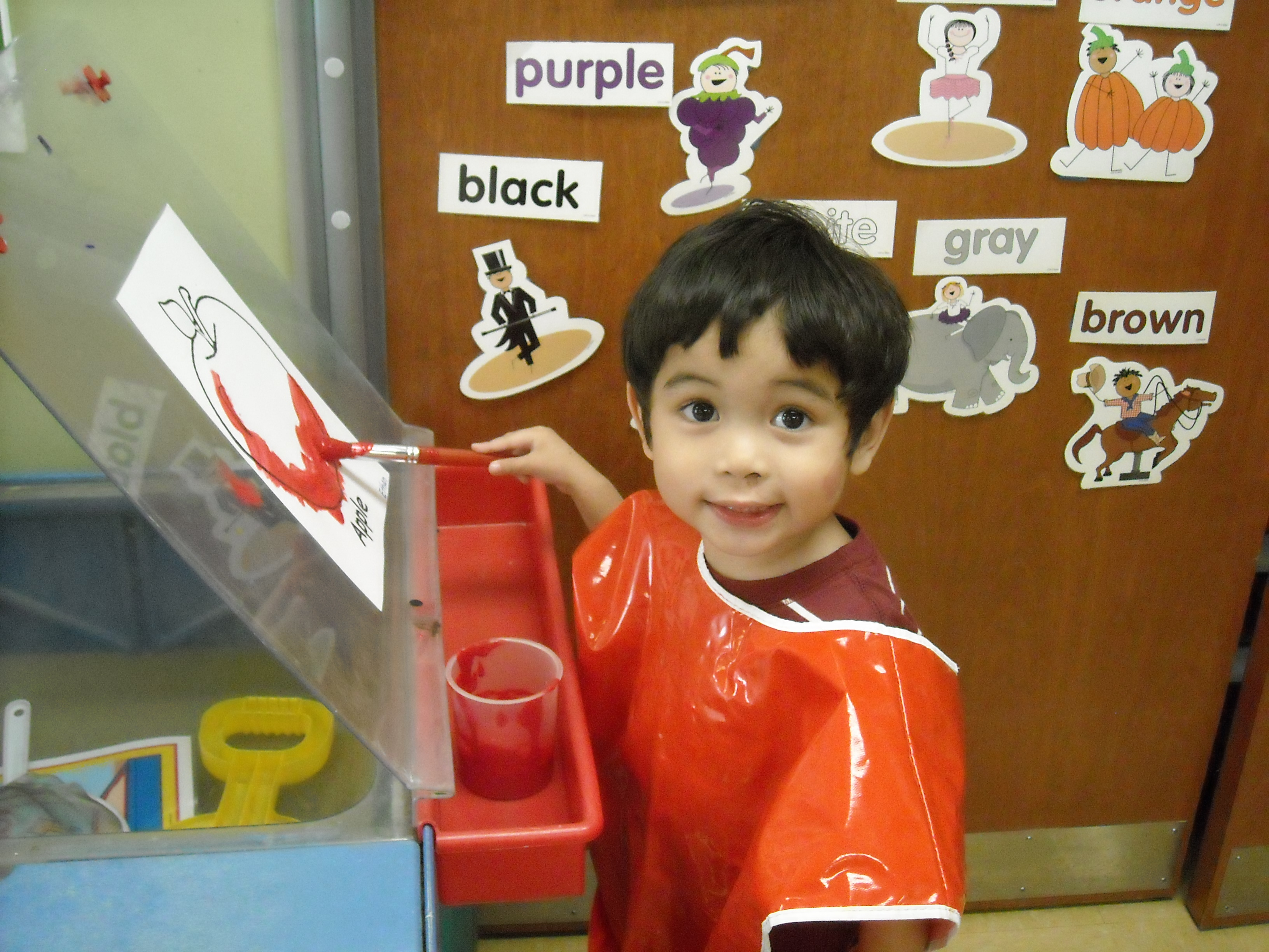 Painting and learning at Growing Tree Preschool.