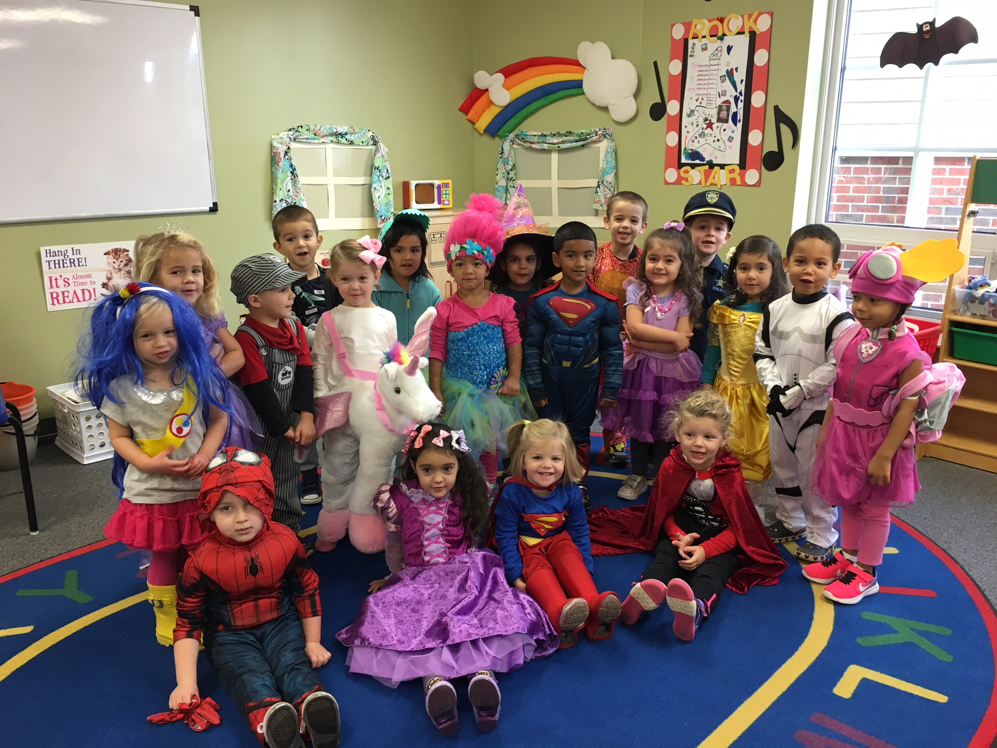 Growing Tree Preschool poses for a photo on Halloween.